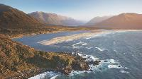 Aerial view over Long Reef and Martin's bay on the Fiordland, Hollyford and Stewart Island Trek |  <i>Hollyford Track</i>