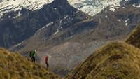 Trekkers on Buchanan peak with Mount Aspiring behind, walking above Matukituki valley, near Lake Wanaka |  <i>Colin Monteath</i>