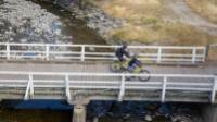 Crossing one of the many bridges along the Otago Rail Trail |  <i>Tom Powell</i>