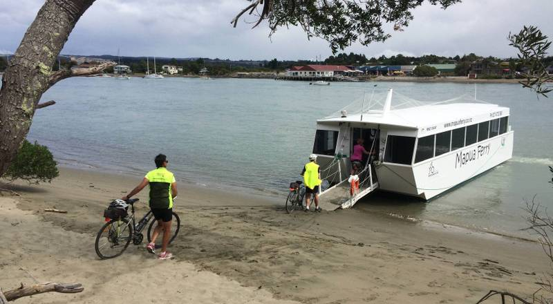 Boarding the Mapua Ferry after a stunning ride on Rabbit Island |  <i>Chris Cameron</i>