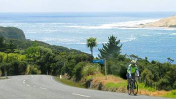 Road cycling along the coastline of Northland New Zealand