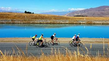 Cycling group enjoying views of the turquoise Hydro-Canals near Twizel. | Rossco Daubney